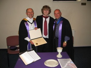Graduating with Distinction, Joshua Searle, MTh in Applied Theology, with the Rector and the Academic Dean