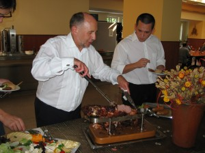 Is the Rector imagining certain students as he carves the meat?!